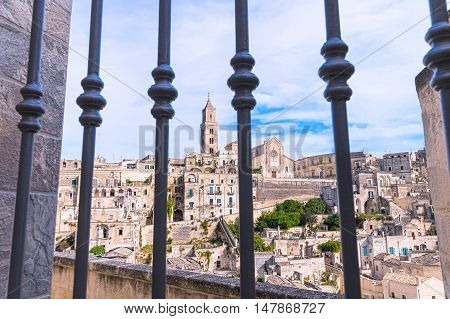 Panoramic View Of Typical Stones (sassi Di Matera) And Church Of Matera View Through Gate Under Blue