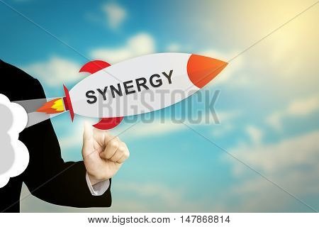 business hand clicking synergy flat design rocket