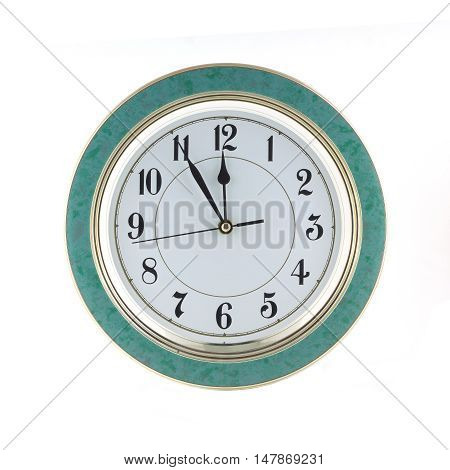 Almost twelve o'clock on big wall clock isolated on white closeup
