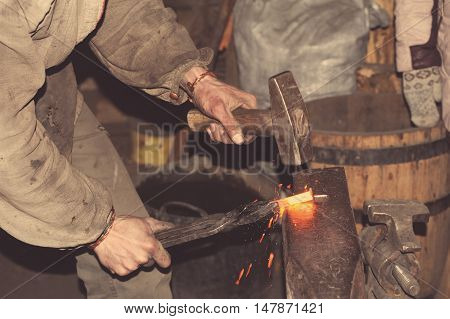 Blacksmith Forges A Red-hot Metal Hammer