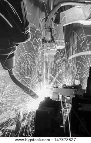 The Welding robots movement in a car factory.