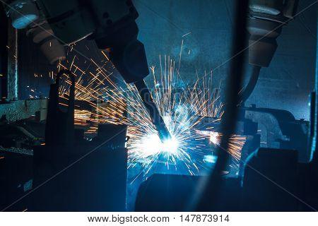 Welding robots movement in a car factory.