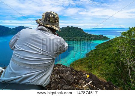 Tourists enjoying amazing view from top of Bohey Dulang island Semporna,Sabah.The greatest tourist attraction of Semporna with bright blue water & rocky shore in the islands