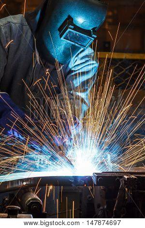 The Industrial steel welder auto parts in factory.
