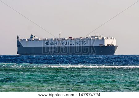 Sharm El Sheikh Egypt - November 28 2010: Vehicles Carrier vessel Hoegh Triton sails along the shore of the Red Sea near Sharm El Sheikh Egypt at November 28 2010. Type of vessel: Vehicles Carrier. Flag: Norway.