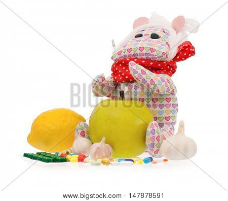 Cute toy hippopotamus with pills - handmade, isolated on white background