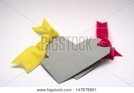 Tags with velvet bows colorful on neutral background