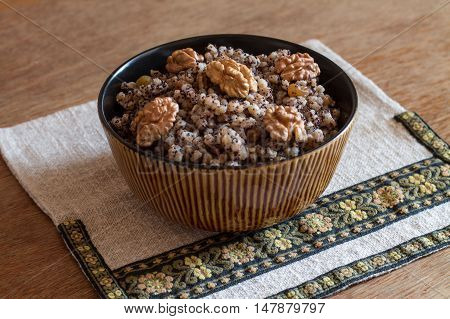 Kutia is a sweet grain pudding, traditionally served in Ukraine, Belarus and some parts of Poland. Kutia is often the first dish in the traditional twelve-dish Christmas Eve.