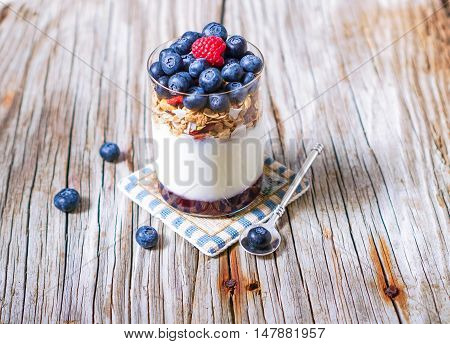 Healthy Yogurt Parfait and Granola with Nuts and Berries. Healthy breakfast. Selective focus.