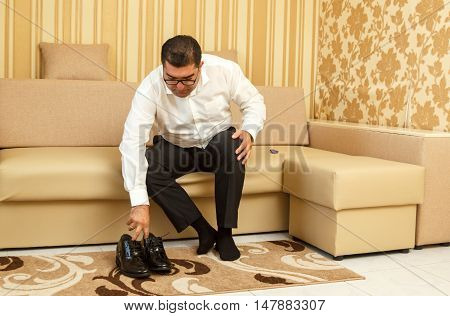 DUNNO UKRAINE - 02 September 2016: Groom wearing classic shoes on wedding day