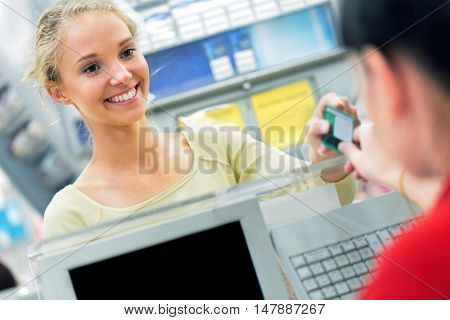 Closeup of a Customer Passing Credit Card to Cashier