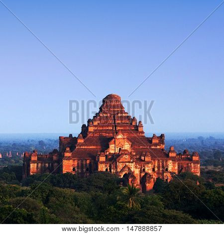 Ancient Dhammayangyi Pagoda at sunset in Bagan archaeological zone in Myanmar