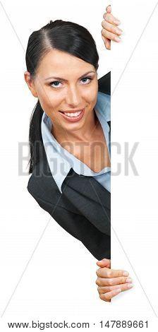 Businesswoman peeking around a corner or object
