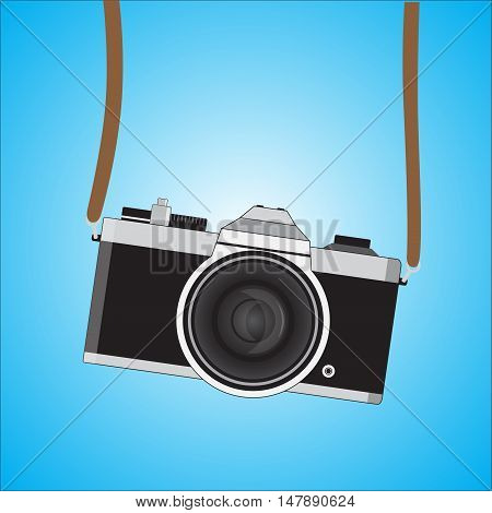 Retro camera in a flat style. Vintage camera on a colored background. Antique hung old camera with strap. Vector Illustration