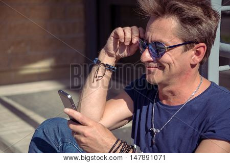 Man Reads The Message From The Phone. The Joyous Look