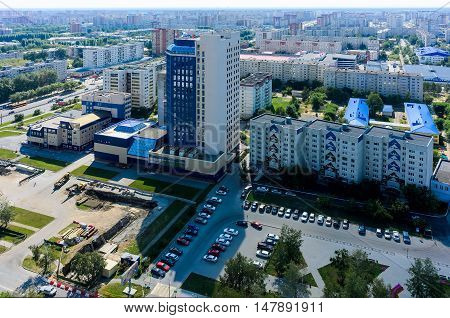 Tyumen, Russia - August 9, 2016: Aerial view on city quarters and building of JSC Siberian Scientific Analytical Center