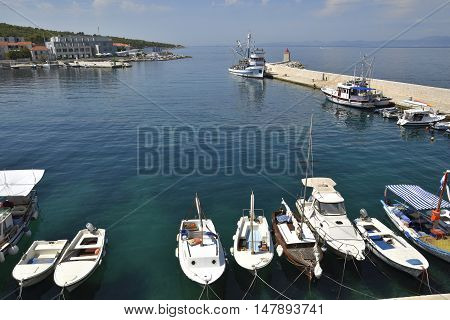 Postira harbor view to the North with some boats in foreground picture from Postira Brac Croatia.