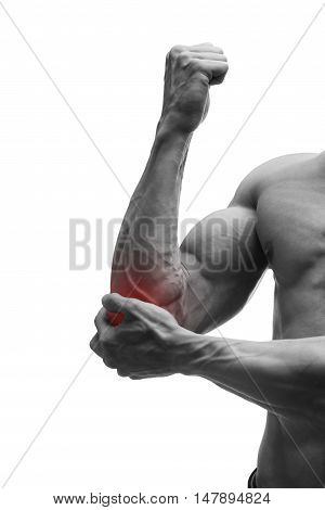 Pain in the elbow muscular male body isolated on white background with red dot black and white photography