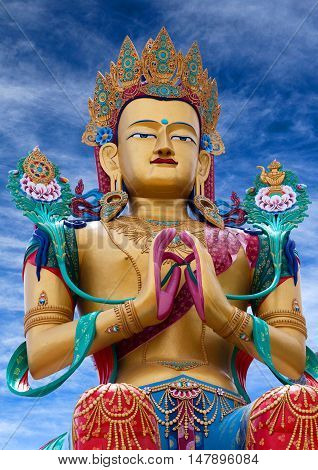 LADAKH, INDIA - JUNE 14, 2012: Statue of Maitreya Buddha near Diskit Monastery facing down the Shyok River towards Pakistan.