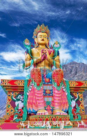LADAKH, INDIA - JUNE 14, 2012: Statue of Maitreya Buddha near Diskit Monastery facing down the Shyok River towards Pakistan in Nubra Valley Jammu and Kashmir India.