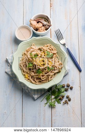 spaghetti with tuna anchovies capers and lemon peel