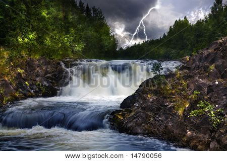 waterfall in green forest under thunderstorm clouds with lightning