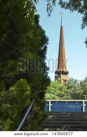 Bucharest, ROMANIA - August 21 2016: An old wooden church seen from IOR park in Bucharest. BUCHAREST -August 21 2016
