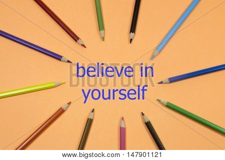 Colored Pen written showing to center with a word belive in yourself