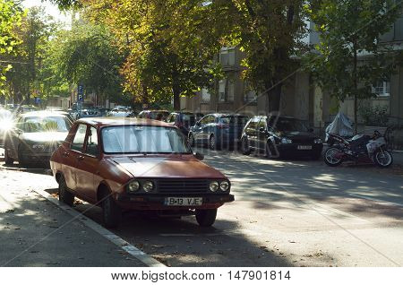 Bucharest, ROMANIA - August 21 2016: An old red Dacia car on the streets in Bucharest. Dacia is one of Romania's top companies. BUCHAREST -August 21 2016