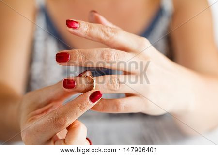 Woman Is Taking Off The Ring From Hand
