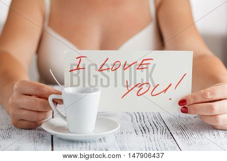 Woman Holding A Paper Message With The Text I Love You
