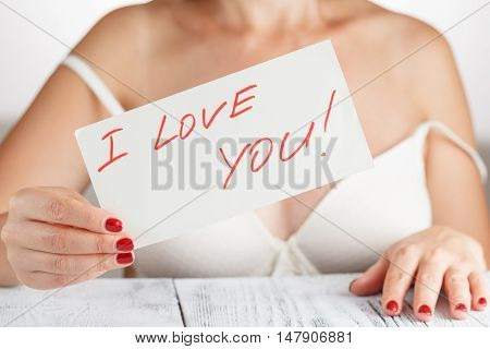 woman in bra with a foul love you