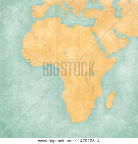 Sierra Leone (Sierra Leonean flag) on the map of Africa. The map is in soft grunge and vintage style like watercolor painting on old paper.