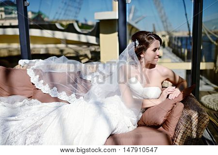 Beauty Bride In Bridal Gown With Lace Veil In The Nature. Beautiful Model Girl In A White Wedding Dr