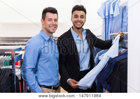 Two Handsome Business Man Fashion Shop, Happy Smiling Mix Race Friends Customers Choosing Clothes Shirts In Retail Store Young People Shopping Formal Wear