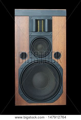 Loud speaker system with wood finish and metal black grills isolated on black background front view closeup