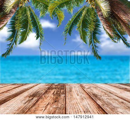 Blurred image of sea sky coconut tree with wooden under