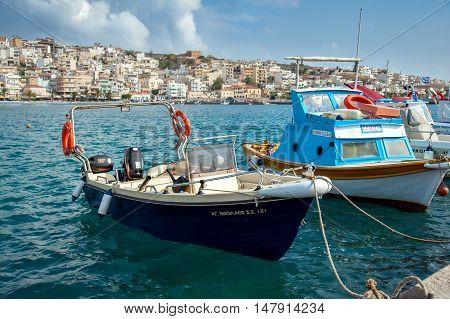 SITIA, CRETE, GREECE -  JUNE 2016: Traditional Greek fishing boat at port of Sitia town at eastern part of Crete island, Greece