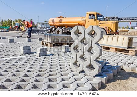 Symmetrical and decorative precast shape is ready to be placed in parking spot.