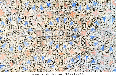 TUNIS TUNISIA - SEPTEMBER 2 2015: The ganch carving with the colorful stellar patterns on the wall in Bardo National Museum located in Hafsid Palace on September 2 in Tunis.