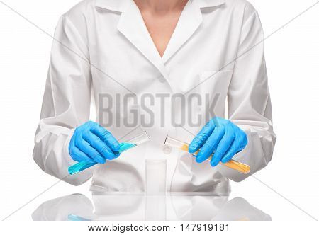 Female Holding Test Tubes Over Measuring Cup