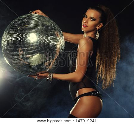 young dancer girl in smoke with disco ball