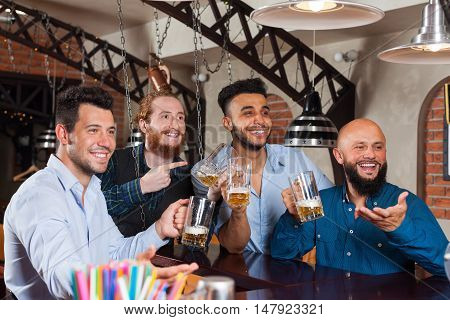 Man Group In Bar Hold Empty Beer Glasses, Standing At Counter Order Barman, Mix Race Cheerful Friends Meeting Pub Communication