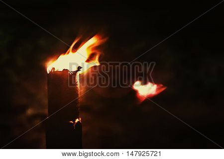 Abstract blurred background with a burning torch in the night