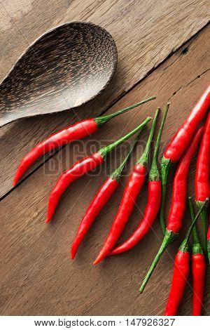 chilli on wood table chilli . .