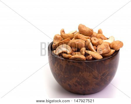 Roasted cashew nuts Placed on a white background.