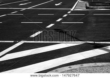 Detail of a traffic lines on asphalt at one intersection.