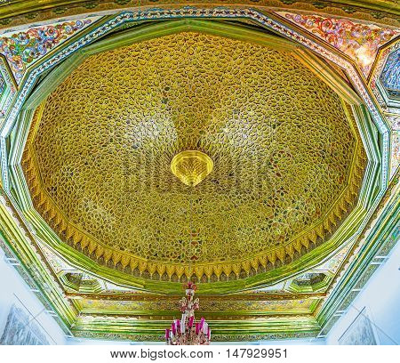 TUNIS TUNISIA - SEPTEMBER 2 2015: The great golden cupola of the Sousse Room in Bardo National Museum with carved islamic patterns and painted floral details on September 2 in Tunis.