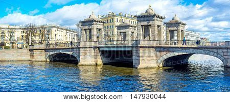 SAINT PETERSBURG RUSSIA - APRIL 25 2015: Panorama of towered Lomonosov Bridge with architectural ensemble of Lomonosov Square on the background on April 25 in Saint Petersburg.