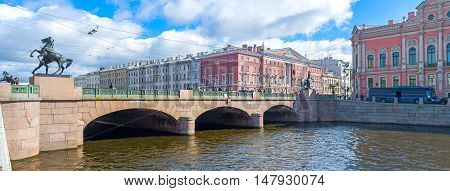 SAINT PETERSBURG RUSSIA - APRIL 25 2015: The statues of the Horse Tamers at four corners of Anichkov Bridge across Fontanka River on April 25 in Saint Petersburg.